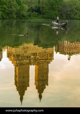 The San Remo reflecting off of the Central Park pond